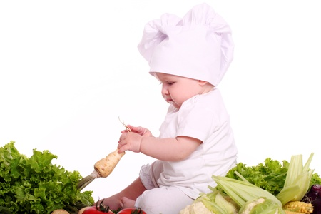 Cute baby chef with different vegetables over white background Stock Photo - 15646426