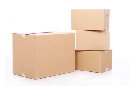 moving crate: Pile of cardboard boxes over white background