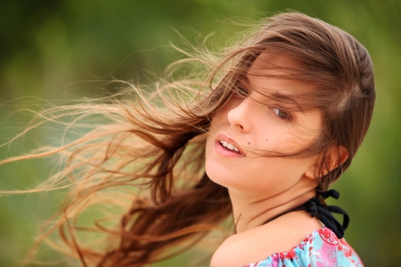 Portrait of  young woman smiling with windswept hair  photo