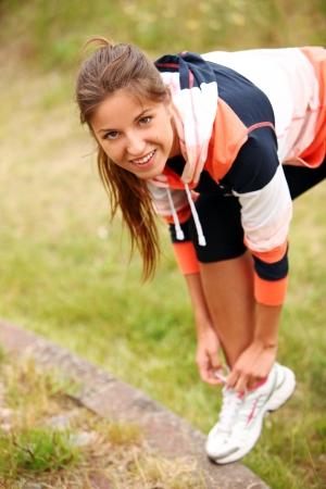 tying: Woman trying running shoes