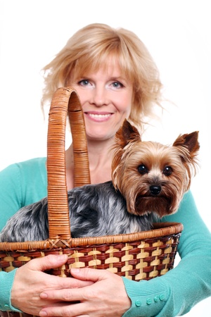 Happy mid age woman ang her yorkshire terrier over white background photo
