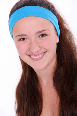 hairband: Smiling fitness girl with blue hairband over white background