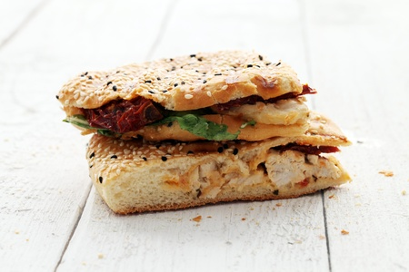 Close up of fresh and tasty sandwich on wooden table photo