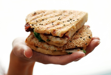 Woman holding fresh sandwich in her hand photo
