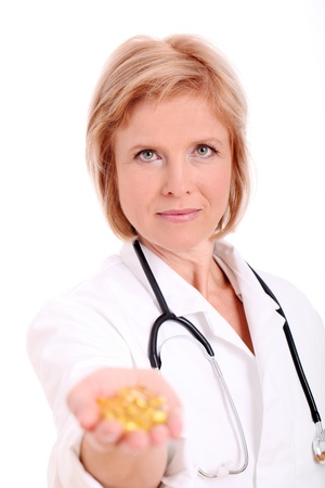 birth prevention: Adult woman doctor with pills in her hand over white background