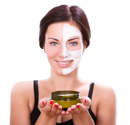 Beautiful woman  with facial mask over white background  Stock Photo