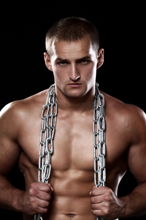 naked abs: Handsome and muscular guy with chains over his body