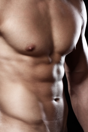 Muscular and sexy torso of young man photo