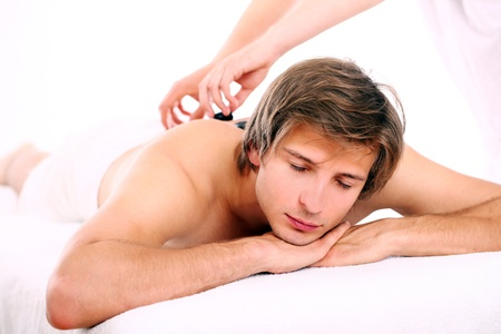 Young and handsome guy relaxing at massage session  photo