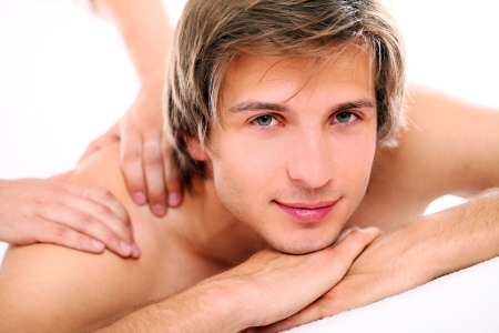Young and handsome guy relaxing at massage session  Stock Photo - 24548215