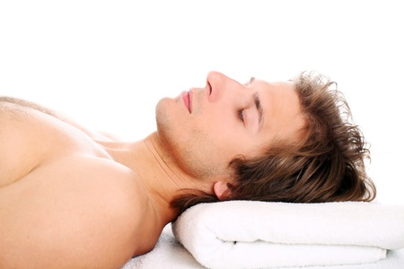 Young and handsome guy relaxing at massage session Stock Photo - 24548216