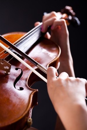 Close up of woman playing on a violin photo