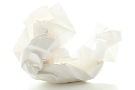 crumpled paper: Crumbled paper over white background
