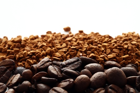 Ground and instant coffee  over white background photo