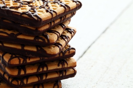 Fresh chocolate cookies on wooden table photo