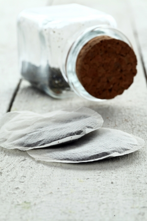 Close up of two teabags on wooden table photo
