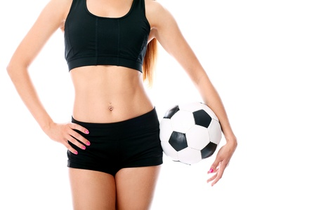 Young and sexy girl s body with soccer ball over white background photo