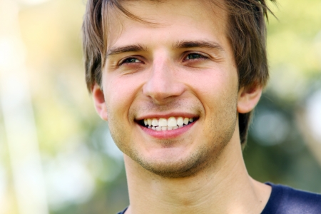 Portrait of young and smiling cute man in park Stock Photo - 16227325
