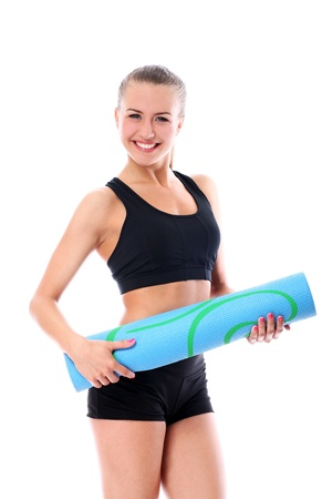 Young smiling woman holding mat for fitness Stock Photo - 16226300