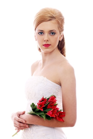Portrait of young bride with red roses photo