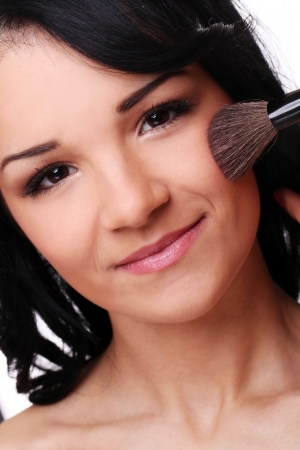 beautifull woman: Portrait of beautifull woman with brush isolated on a white