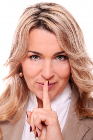 Closeup of mature woman quiet gesture on a white background