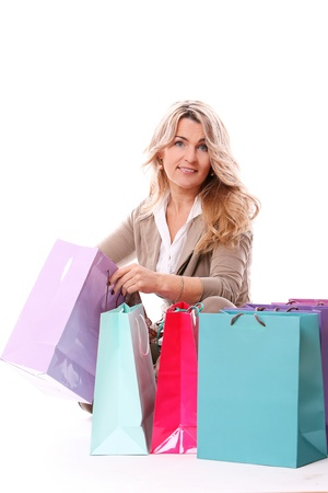 Beautiful middle aged woman checking her shopping bags photo