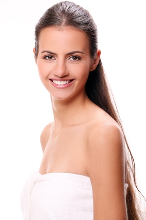 Portrait of beautiful smiling woman with cute smile in towel photo