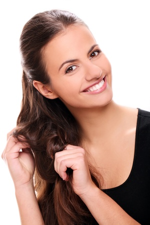 Portrait of Attractive smiling woman touching her hair photo