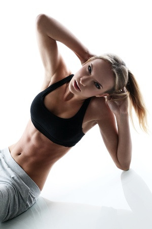 sporty and attractive woman do fitness exercise isolated on a white Stock Photo - 16470124