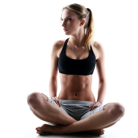 sporty and attractive woman do yoga exercise isolated on a white photo