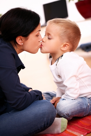 love kiss: Portrait of Mother with happy son at home Stock Photo