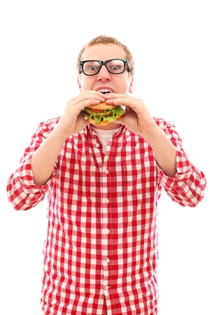 american cuisine: Funny man in glasses eating hamburger isolated on a white