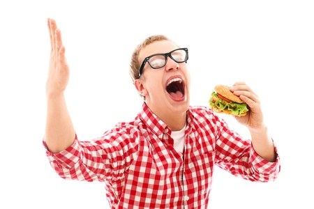 gagging: Funny man in glasses eating hamburger isolated on a white