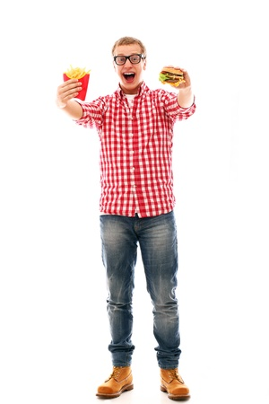 Funny man in glasses with crisp french fries and hamburger