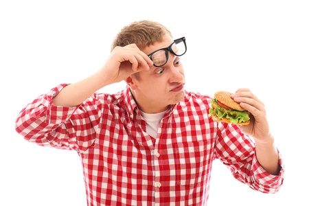 gagging: Funny man in glasses looking at hamburger isolated on a white Stock Photo
