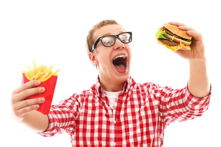 gagging: Funny man in glasses with crisp french fries and hamburger