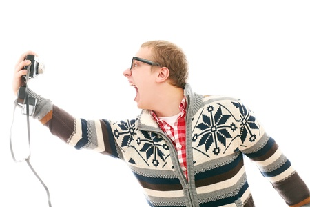 Crazy man with camera shooting him self isolated on a white Stock Photo - 16732895