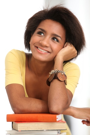 Young and beautiful afro woman studying with books Stock Photo - 16749477