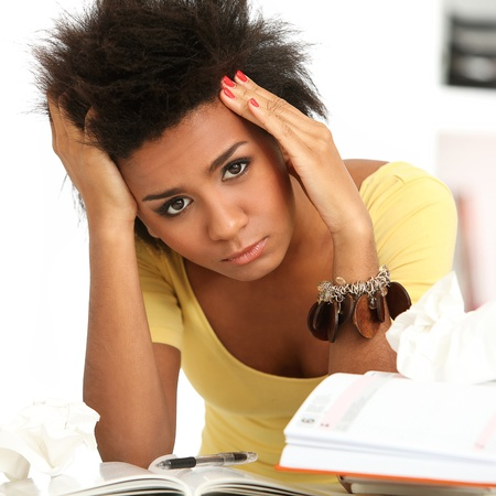 Young black woman tired from studying with books Stock Photo - 16749189