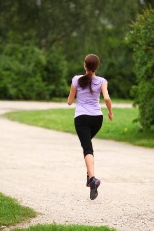 Young and attractive sporty girl running in the park Stock Photo - 16749282