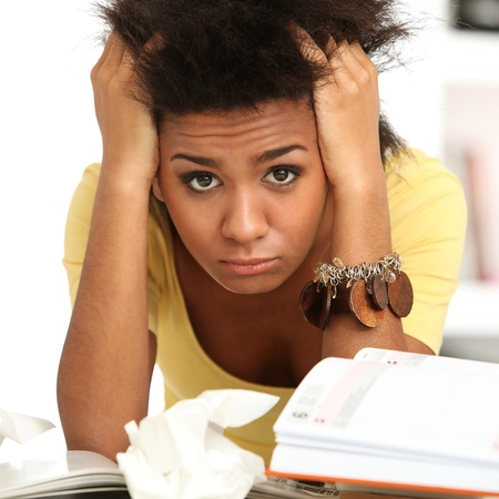 Young black woman tired from studying with books Stock Photo - 16749341
