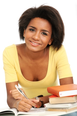 Young and beautiful afro woman studying with books Stock Photo - 16749671