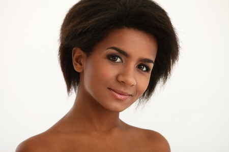 Beautiful and attractive black woman portrait isolated on a white Stock Photo - 16749652
