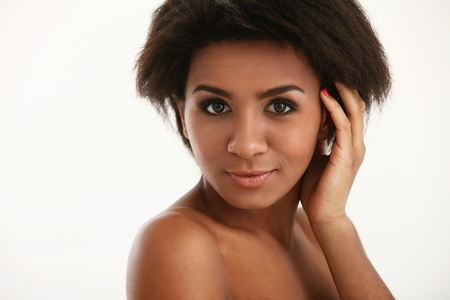 Beautiful and attractive black woman portrait isolated on a white Stock Photo - 16749620