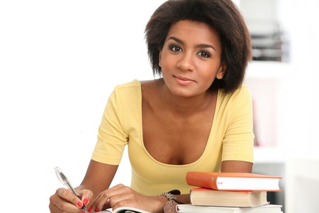 Young and beautiful afro woman studying with books Stock Photo - 16749595