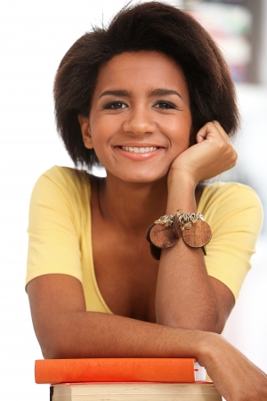 Young and beautiful afro woman studying with books Stock Photo - 16749658
