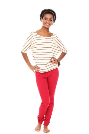 Young smiling black woman in studio isolated on a white Stock Photo - 16749523