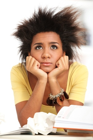Young black woman tired from studying with books Stock Photo - 16749655