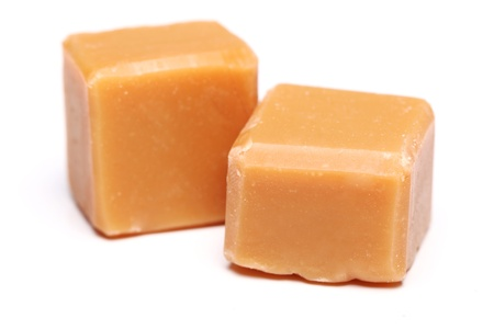 fudge: Tasty brown butterscotch isolated on a white
